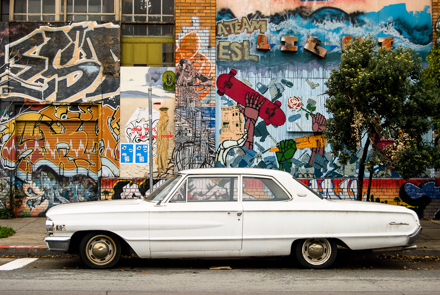 White Ford with Graffiti