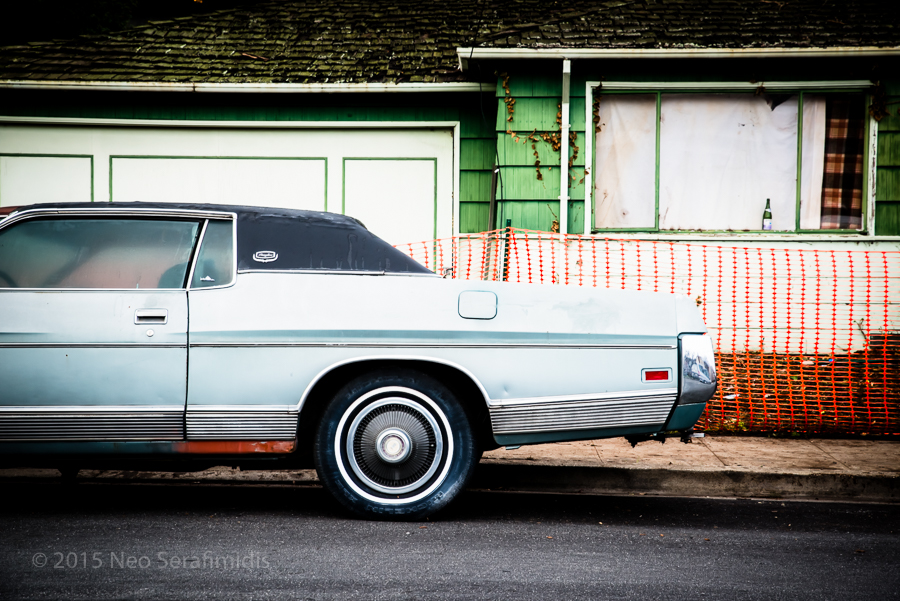 Ford LTD sits parked outside the former home of its deceased owner. Albany, CA. December, 2015